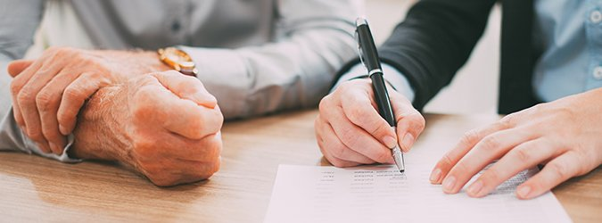 Unrecognizable woman signing contract at meeting_tone