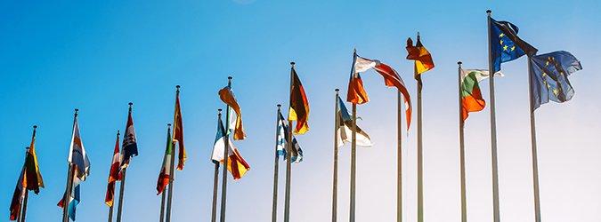 European Union flags against blue sky