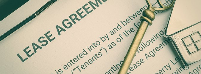 Business lease agreement concept : Keychain on a lease agreement form. Lease agreement is a contract between a lessor and a lessee that allow lessee rights to use of a property owned by lessor