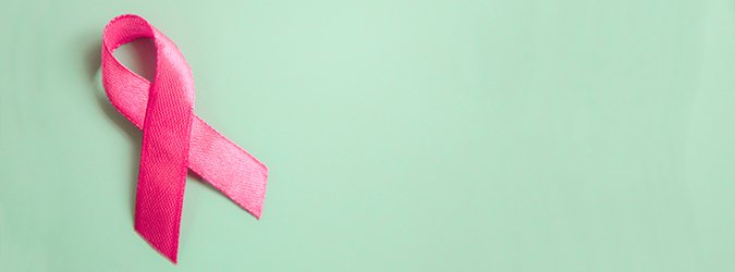 pink ribbon breast cancer on a blue background. top view  top. Place for text