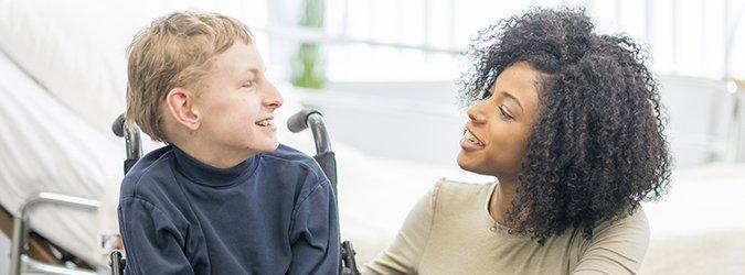 Caregiver Talking to Little Boy